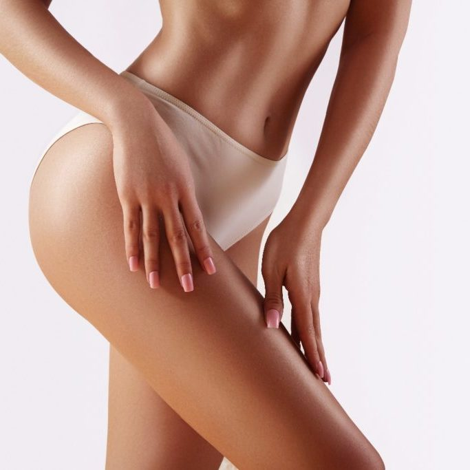 Spa and wellness. Healthy slim body in white panties. Beautiful sexy hips with clean skin. Fitness or plastic surgery. Perfect buttocks without cellulite.
